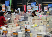 Visitors read books at the Big Bad Wolf Book Sale, which calls itself the world's biggest