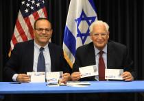 COMMUNICATIONS MINISTER Ayoub Kara (left) and US Ambassador David Friedman display first day covers