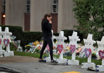 A woman reacts at a makeshift memorial outside the Tree of Life synagogue following Saturday's shoot