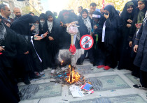 Iranian protesters burn an effigy of U.S. President Donald Trump
