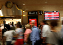 Passengers rush at Penn Station in New York