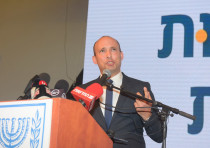 Education Minister Naftali Bennett speaking at a conference