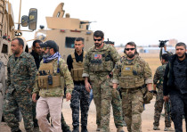 Syrian Democratic Forces and U.S. troops are seen during a patrol near Turkish border in Hasakah, Sy