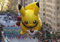 The Pikachu balloon make its way down 6th Ave during the 91st Macy's Thanksgiving Day Parade in the