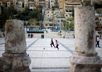 Children play football at the Roman Amphitheatre area in downtown Amman, Jordan April 1, 2018.