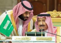 Saudi Arabia's Crown Prince Mohammed bin Salman talks with Saudi Arabia's King Salman bin Abdulaziz