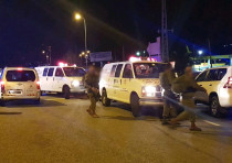 Ambulances gather after six injured in a shooting by Ofra, near Jerusalem.