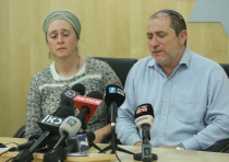 Terror victims parent's Liora and Chaim Silberstein update reporters on their daughter's condition.