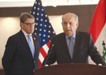 IRAQI OIL MINISTER Thamer Ghadhban (right) speaks during a press conference in Baghdad yesterday