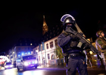 Security forces secure area where a suspect is sought after a shooting in Strasbourg, France, Decemb