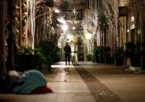 A man walks along a deserted Rue des Orfevres after a shooting in central Strasbourg, France Decembe
