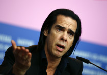 Cast member Nick Cave talks during a news conference promoting the movie