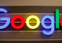 An illuminated Google logo is seen inside an office building in Zurich, Switzerland December 5, 2018