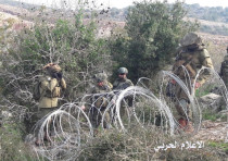 Israeli soldiers set up barbed wire before a confrontation broke out between IDF and Lebanese armed