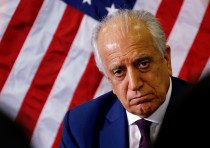 U.S. special envoy for peace in Afghanistan, Zalmay Khalilzad, talks with local reporters at the U.S