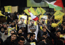 Supporters of Lebanon's Hezbollah leader Sayyed Hassan Nasrallah carry pictures of Hezbollah's late