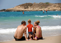 Sunbathers visit the Mediterranean Sea at Dor Beach, northern Israel August 28, 2018. Picture taken