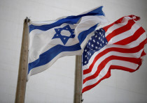 The American and the Israeli national flags can be seen outside the U.S Embassy in Tel Aviv