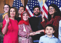 REP. RASHIDA Tlaib (D-Michigan, far right) poses with Speaker of the House Nancy Pelosi