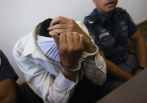 A SUSPECT IN a Jerusalem court. Can the Shin Bet's motto – that it goes after all terrorism equally