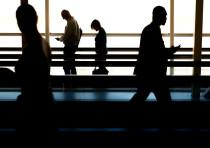 Airport travelers [Illustrative]