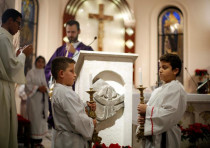Jordanians attend a mass that was held at the Catholic Latin Church in the city of Fuheis near Amman