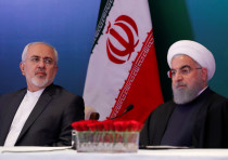 Iranian President Hassan Rouhani (R) and Foreign Minister Mohammad Javad Zarif attend a meeting with