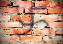 Swastika on a wall (illustrative)