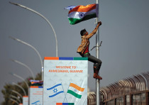 A MAN climbs a pole during Benjamin Netanyahu's visit to India in January 2018