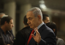 Prime Minister Benjamin Netanyahu arrives at the Knesset ahead of the vote