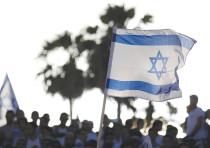 AN ISRAELI flag held aloft on Jerusalem Day.