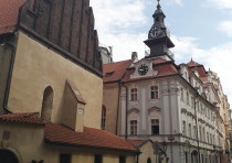 THE CLOCK with Hebrew letters and counterclockwise dial on the Jewish Town Hall in Prague, next to t