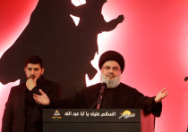 Hezbollah leader Sayyed Hassan Nasrallah addresses his supporters during a public appearance at a re