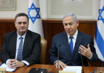 Israeli Prime Minister Benjamin Netanyahu sits next to foreign minister Israel Katz during a cabinet