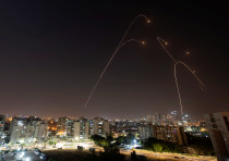 Iron Dome anti-missile system fires interception missiles as rockets are launched from Gaza towards