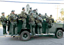 A POLICE SWAT team conducts a manhunt after a mass shooting in San Bernadino, California, on Decembe
