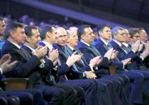 Russian President Vladimir Putin, accompanied in 2017 by the heads of Russia's intelligence services