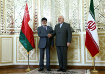 Oman's Minister of State for Foreign Affairs Yousuf bin Alawi bin Abdullah shakes hands with Iran's