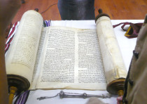 'HAVING CHOSEN God, the Torah is God's response to us.' Pictured: The Yanov Torah, rescued from the