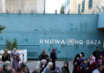 Palestinian employees of United Nations Relief and Works Agency (UNRWA) take part in a protest again