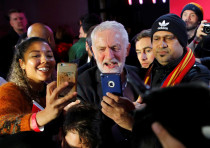 Britain's opposition Labour Party leader Jeremy Corbyn poses for photos with supporters during a gen