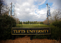 A sign stands at the edge of the campus of Tufts University in Medford, Massachusetts, U.S., Novembe