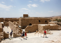 Tourists visit the ancient fortress of Masada