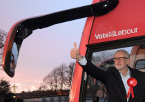 Britain's opposition Labour Party leader Jeremy Corbyn gestures as he arrives to attend a general el