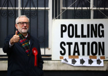 Britain's opposition Labour Party leader Jeremy Corbyn poses outside a polling station after voting
