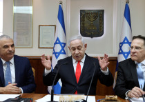 Israeli Prime Minister Benjamin Netanyahu gestures as he chairs the weekly cabinet meeting at his Je
