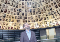 DR. ARKADAI ZELTSER in the Hall of Names at Yad Vashem, Jerusalem.