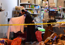 Three people are killed in a kosher supermarket in Jersey City by two members of the anti-Semitic Bl