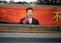 A poster with a portrait of Chinese President Xi Jinping is displayed along a street in Shanghai, Ch