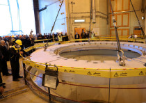 FILE PHOTO: Members of the media and officials tour the water nuclear reactor at Arak, Iran December